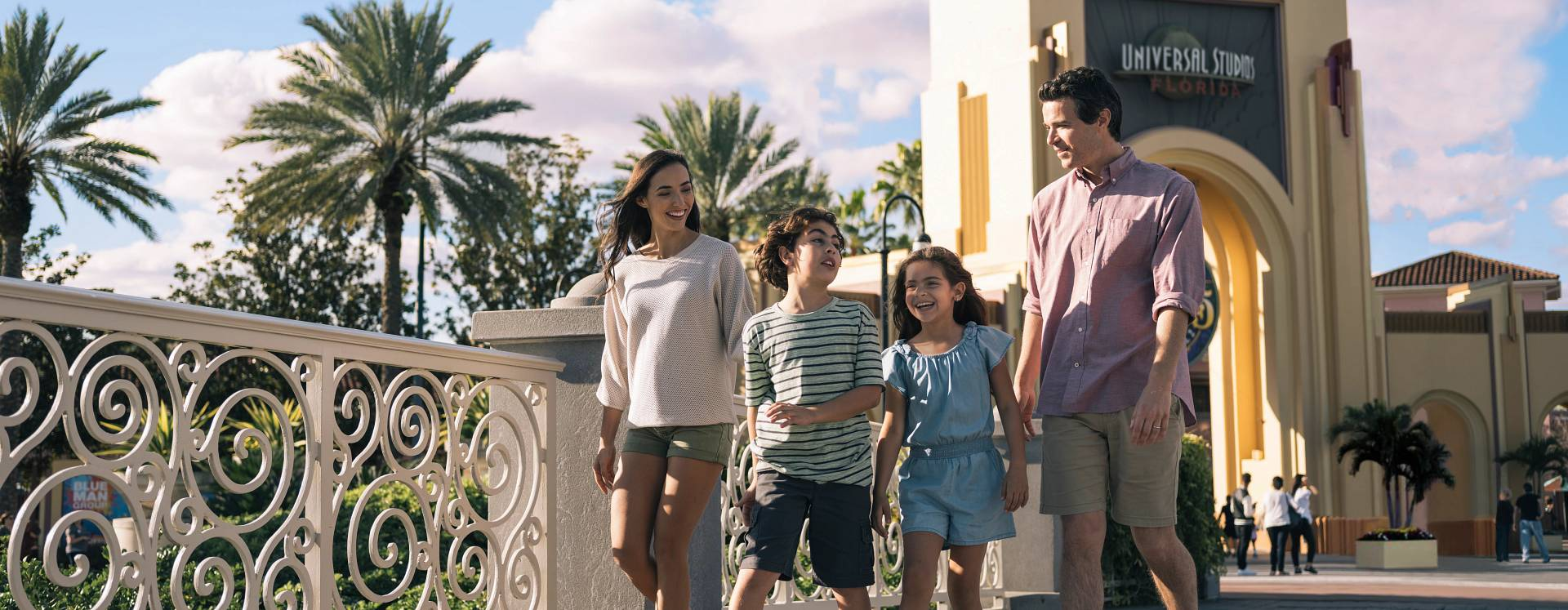 A family walking in front of the entrance to Universal Studios Florida