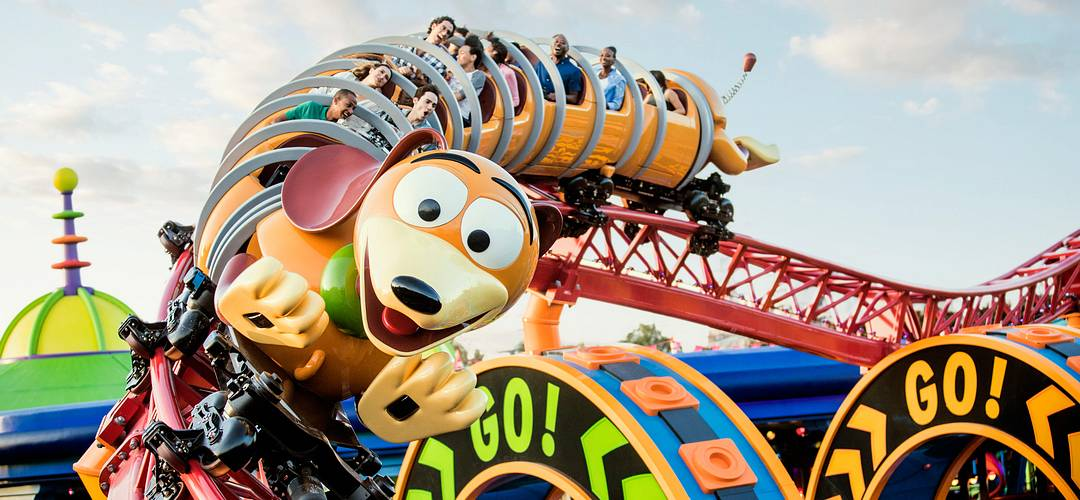 Park guests on the Slinky Dog Dash roller-coaster ride at Disney's Hollywood Studios