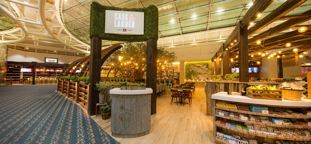 Cask & Larder Brewery & Taproom seating area in Orlando International Airport