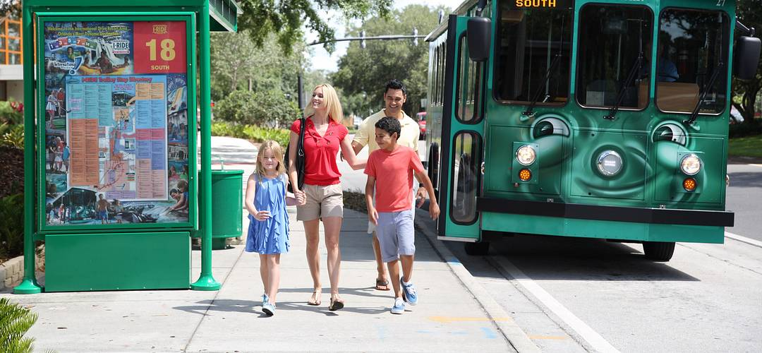 I-Ride Trolley Service - a family walking from a bus stop in Orlando