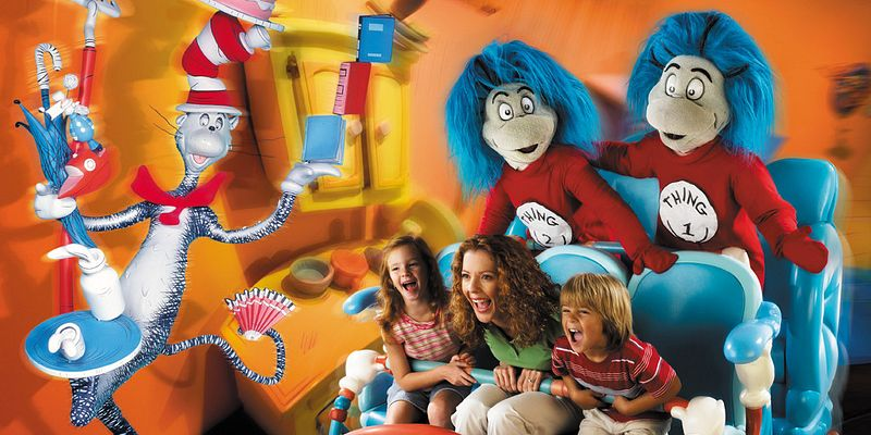 Thing 1 and Thing 2 liven things up, along with the Cat in the Hat, as a mother and her children have fun on The Cat in the Hat™ ride at the Islands of Adventure