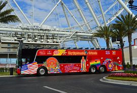 City Sightseeing Orlando tour bus in front of The Wheel at ICON Park
