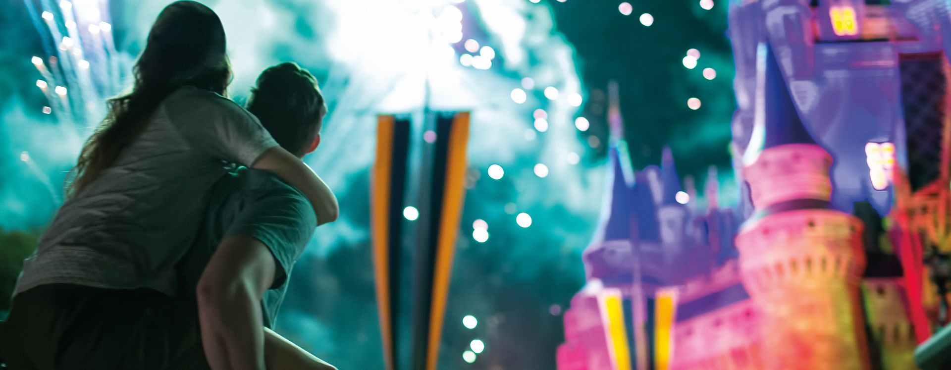 Parkgoers watching spectacular fireworks over Cinderella's Castle at Walt Disney World Resort