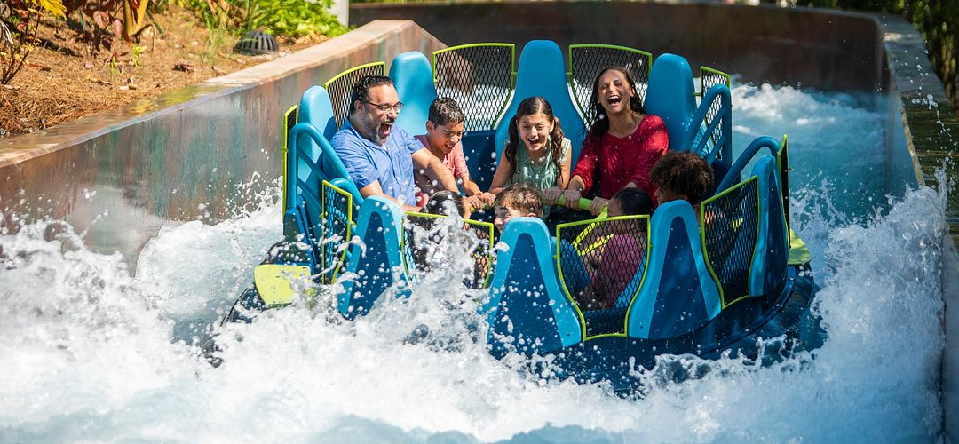 Family on Infinity Falls raft ride at SeaWorld Orlando.