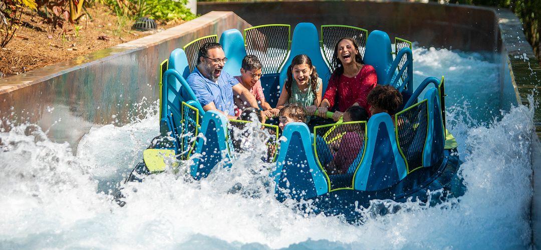 Family on Infinity Falls raft ride at SeaWorld Orlando.