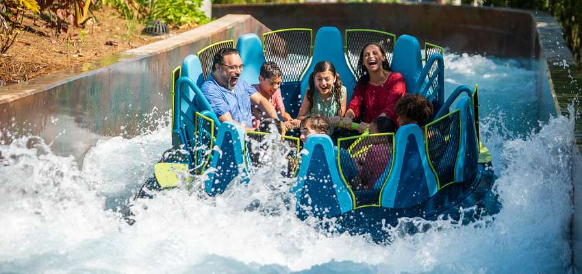 A family riding Infinity Falls at SeaWorld Orlando