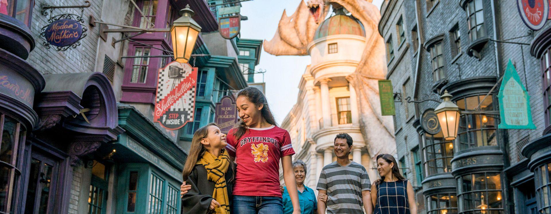 Menina com sua família no mundo mágico de Harry Potter