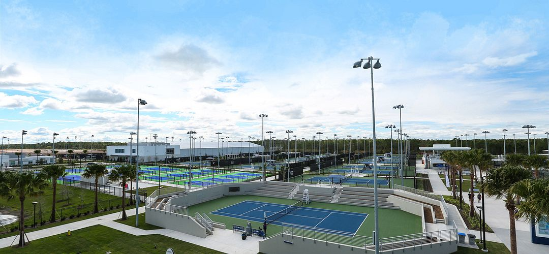 An elevated view of several of the tennis courts at the USTA Campus.