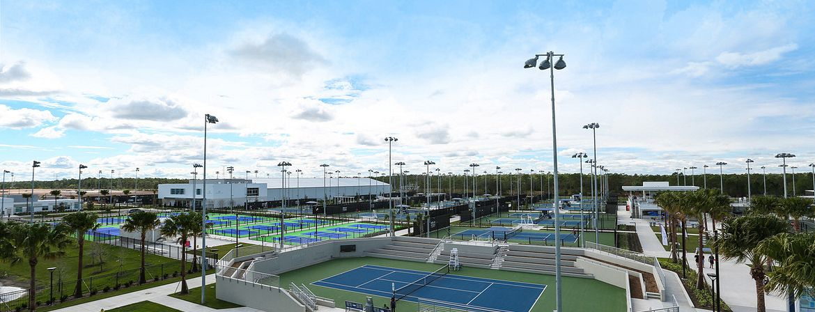 An elevated view of several of the tennis courts at the USTA campus