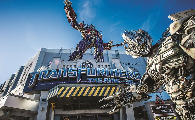 Two Transfromers around the entrance of the Transformers Ride