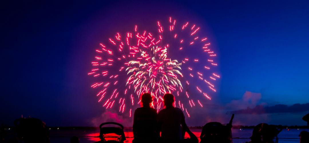 A nighttime shot of a couple watching fireworks on New Year's Eve at LEGOLAND Florida Resort