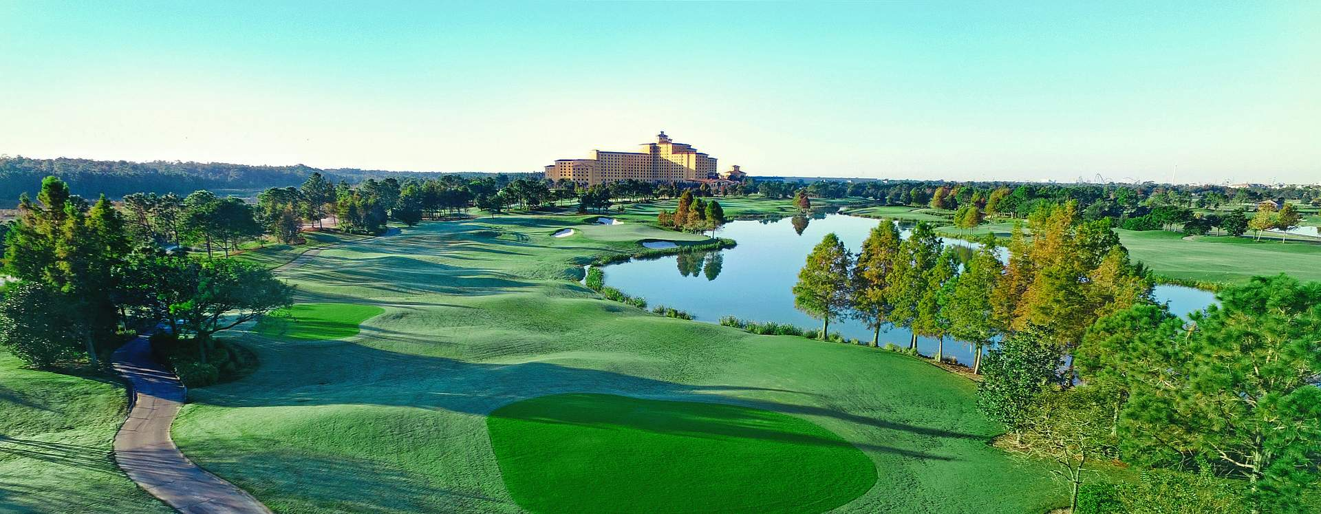 A low, aerial view of the golf course and resort at Shingle Creek Golf Club in Orlando
