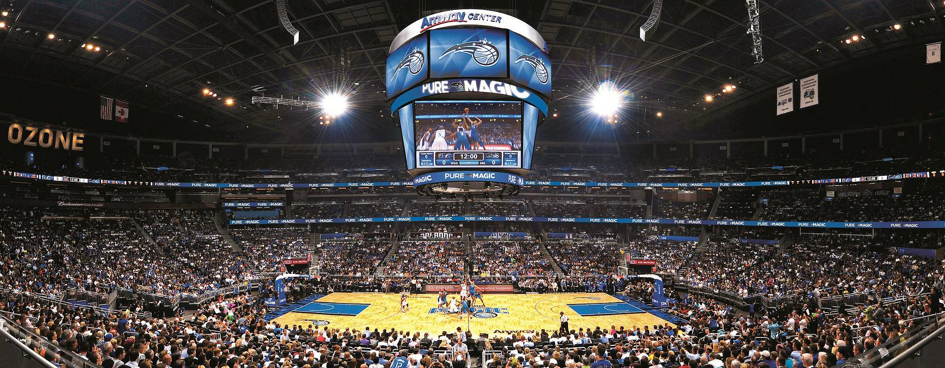 Orlando Magic playing in the Amway Center at the start of a game.