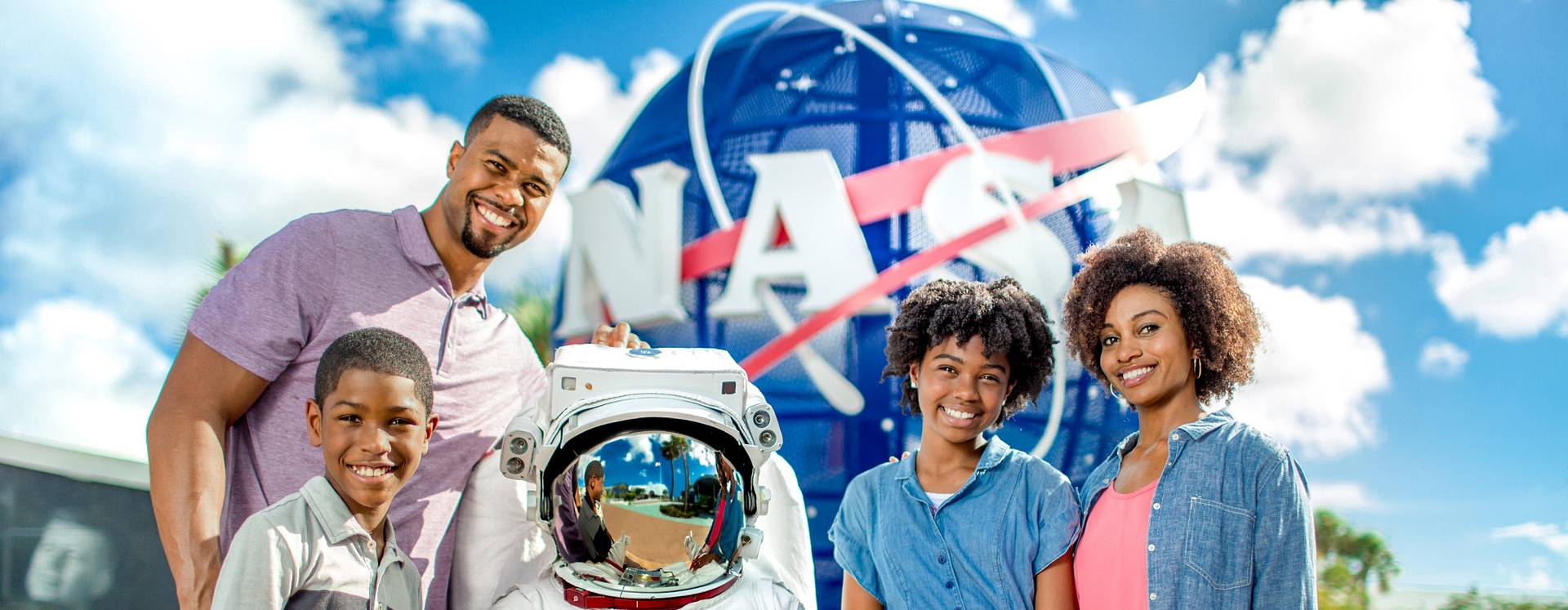 A family posing for a picture with an astronaut