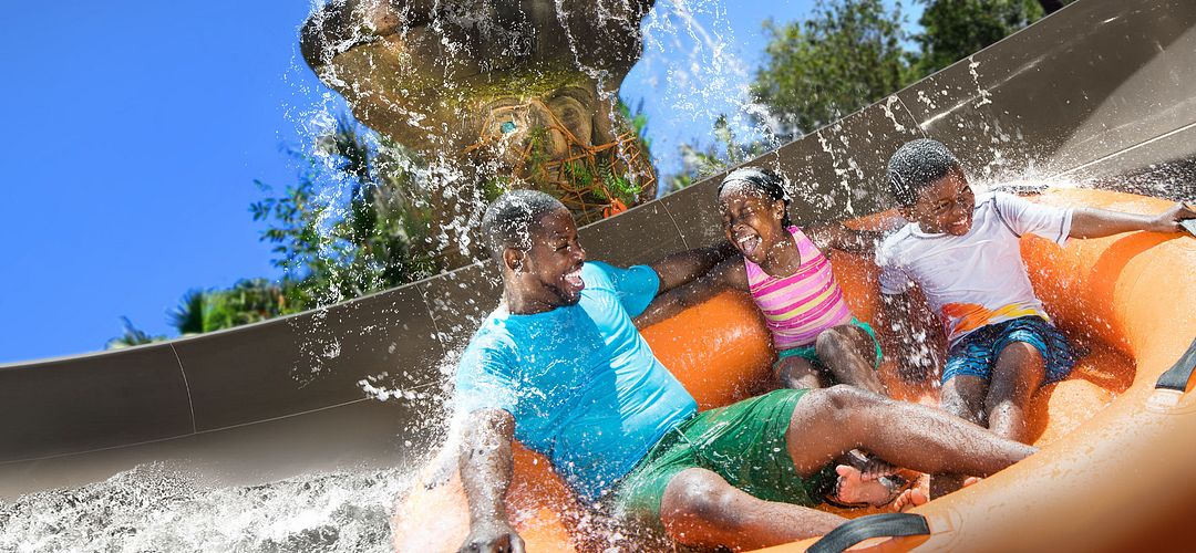 Family aboard a raft on Miss Adventure Falls at Disney's Typhoon Lagoon Water Park