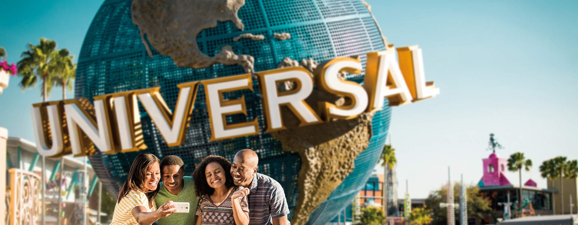 A family taking a group picture in front of the globe at Universal Orlando Resort