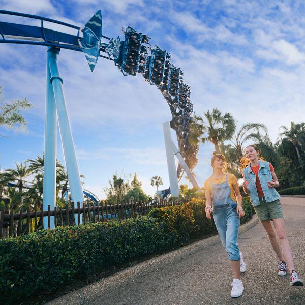 Guests walking by Manta at SeaWorld Orlando