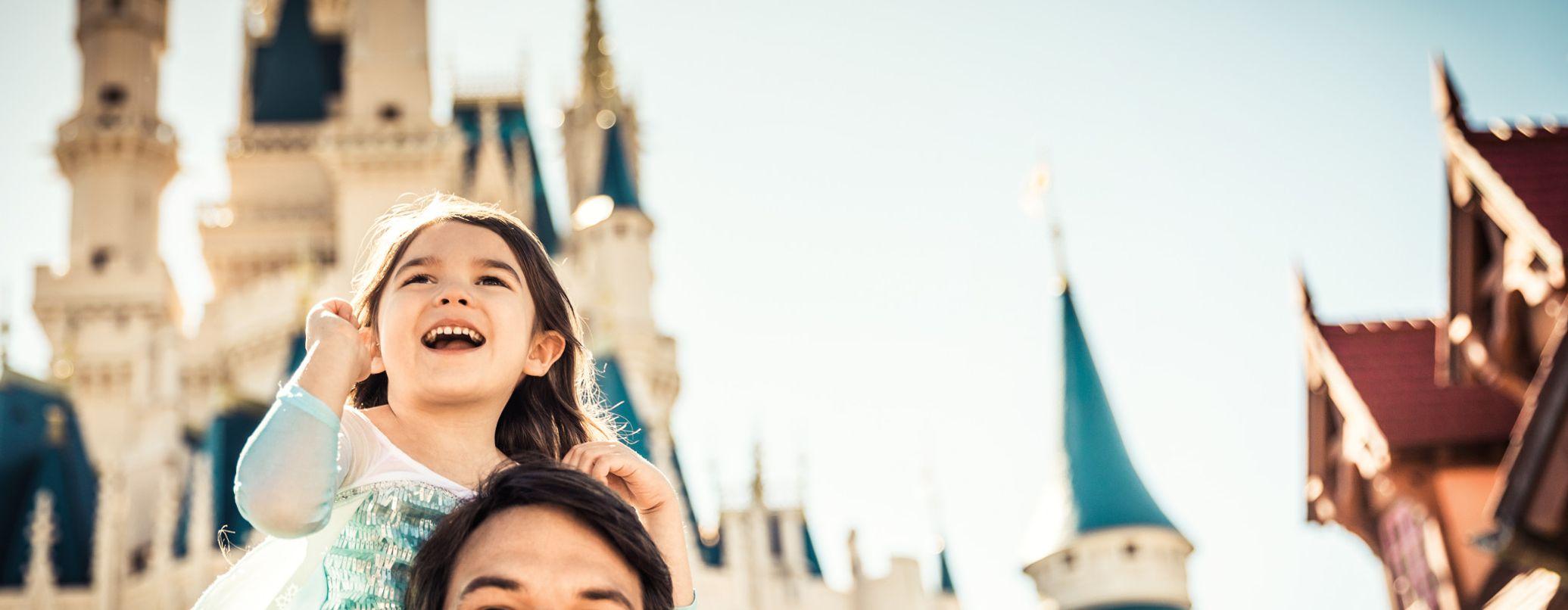 Daughter on Dads Shoulders at Walt Disney World Resort