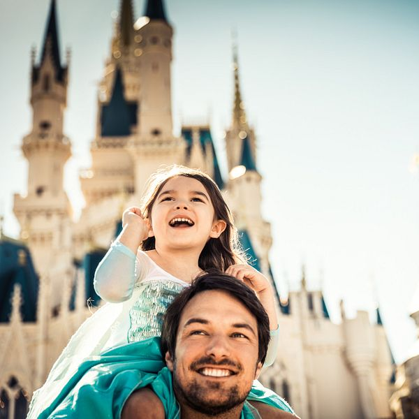 Father and daughter in front of Cinderella Castle at Disney's Magic Kingdom Park