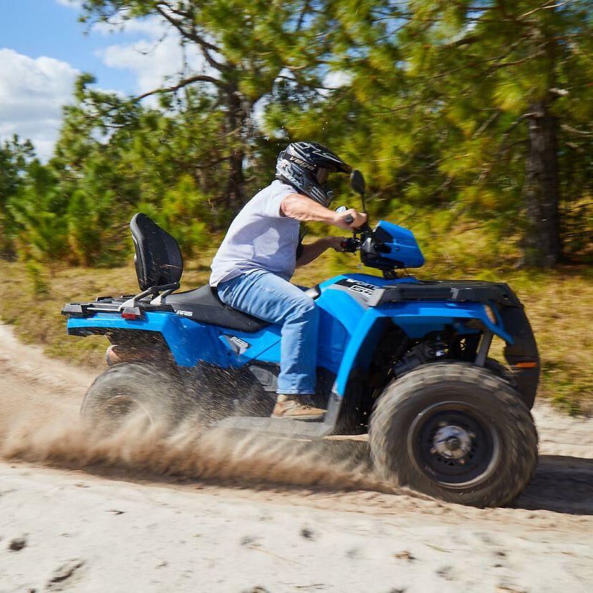 Guy riding an ATV at Revolution Adventures