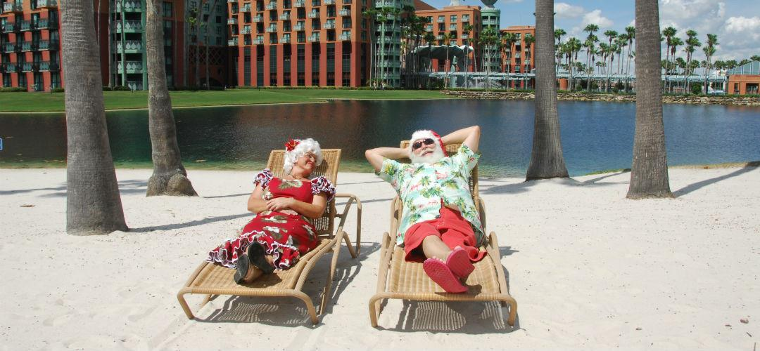 Santa and Mrs. Claus lounge at the Walt Disney World Swan and Dolphin Resort beach