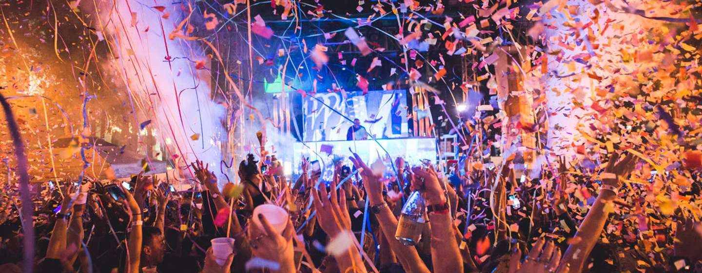 Confetti falling on a crowd during a New Year's eve celebration in downtown Orlando
