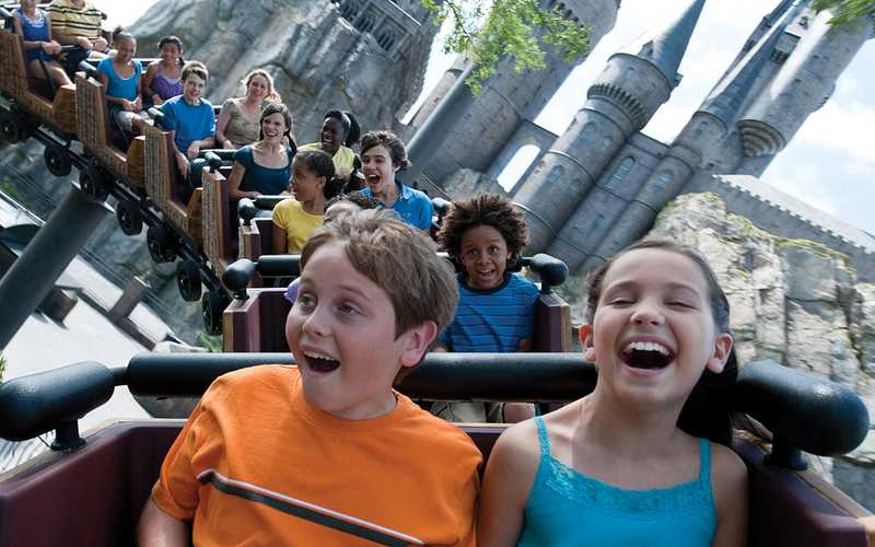 Kids and adults having the time of their lives while riding Flight of the Hippogriff at Islands of Adventure.