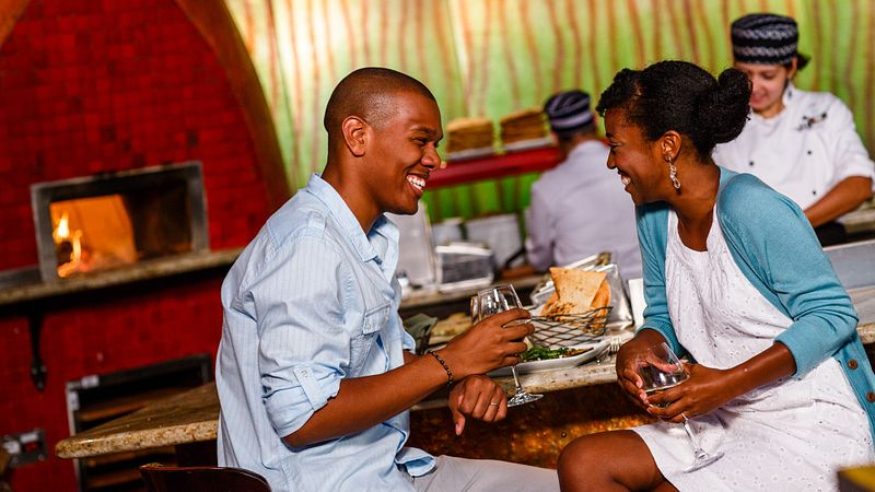 Couple laughing while dining at The Cooking Place in Animal Kindgom's Lodge