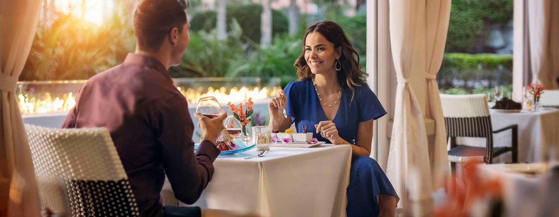 A couple dining outdoors at The Venetian Chophouse