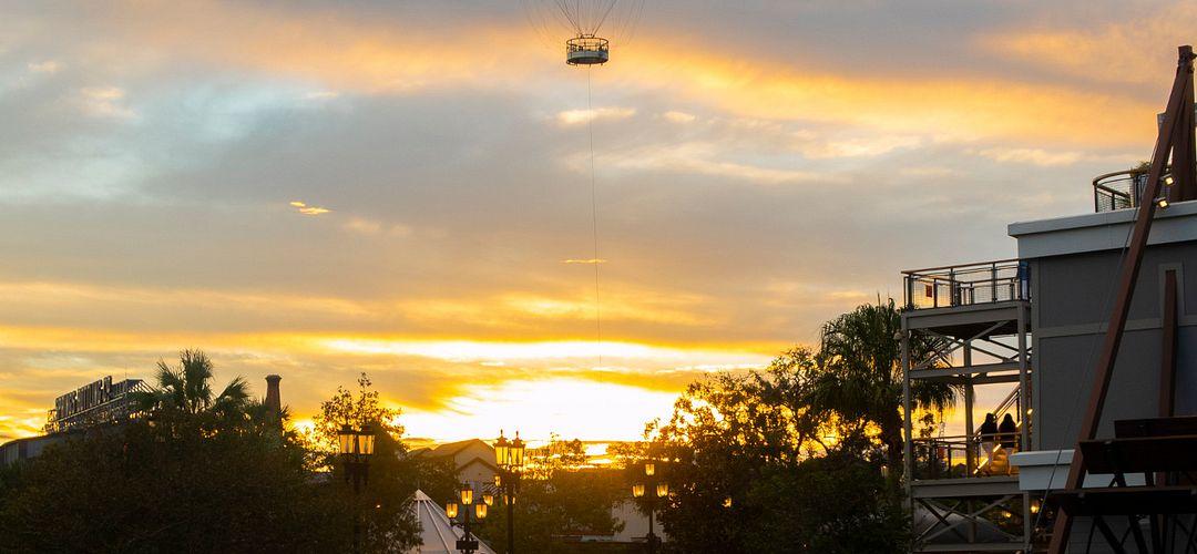 Helium balloon ride at sunset in Disney Springs