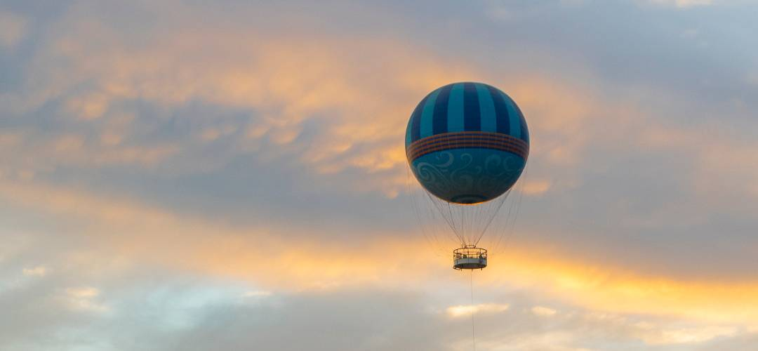 Helium balloon ride at sunset in Disney Springs