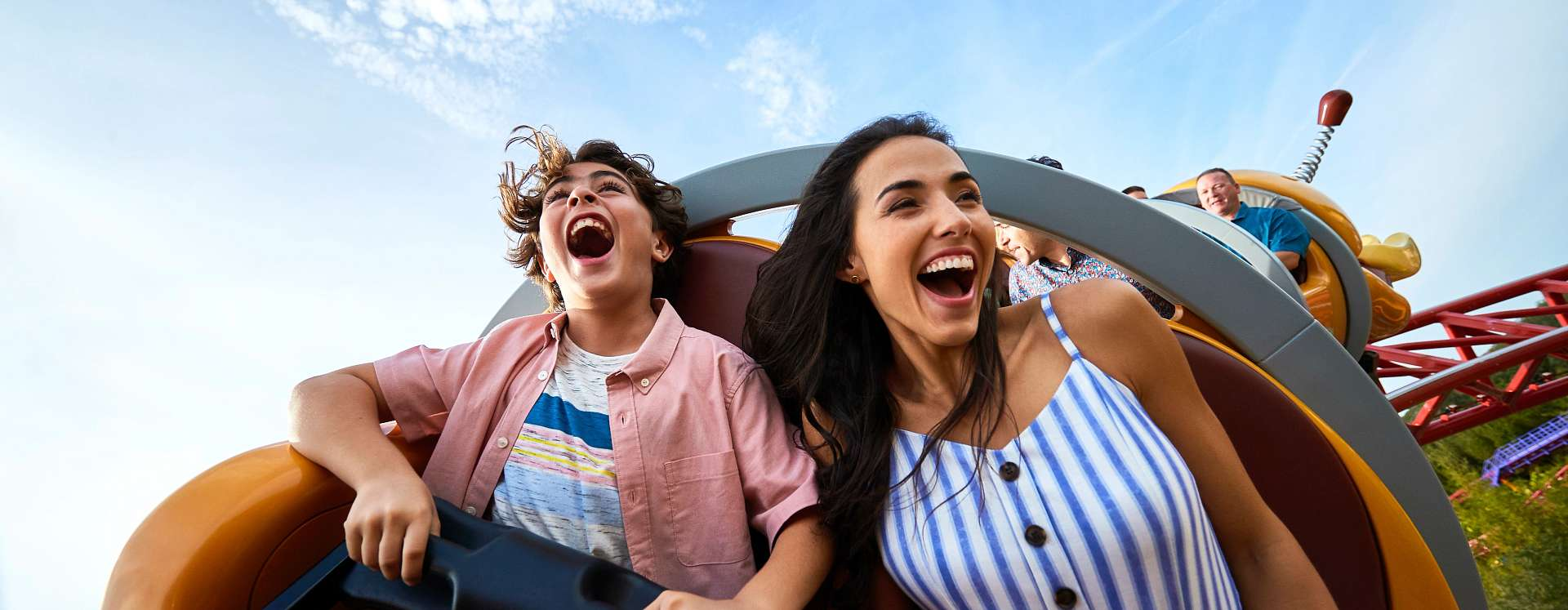 A mother and son on the Slinky Dog Dash rollercoaster in Toy Story Land