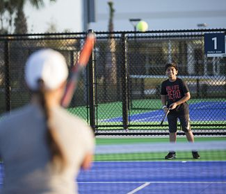 A family-friendly area to watch and play tennis at the USTA campus