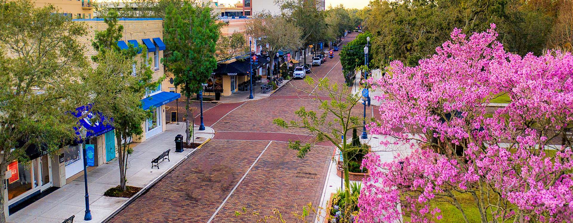 An aerial view of the stores and brick-paved streets in the city of Winter Park.