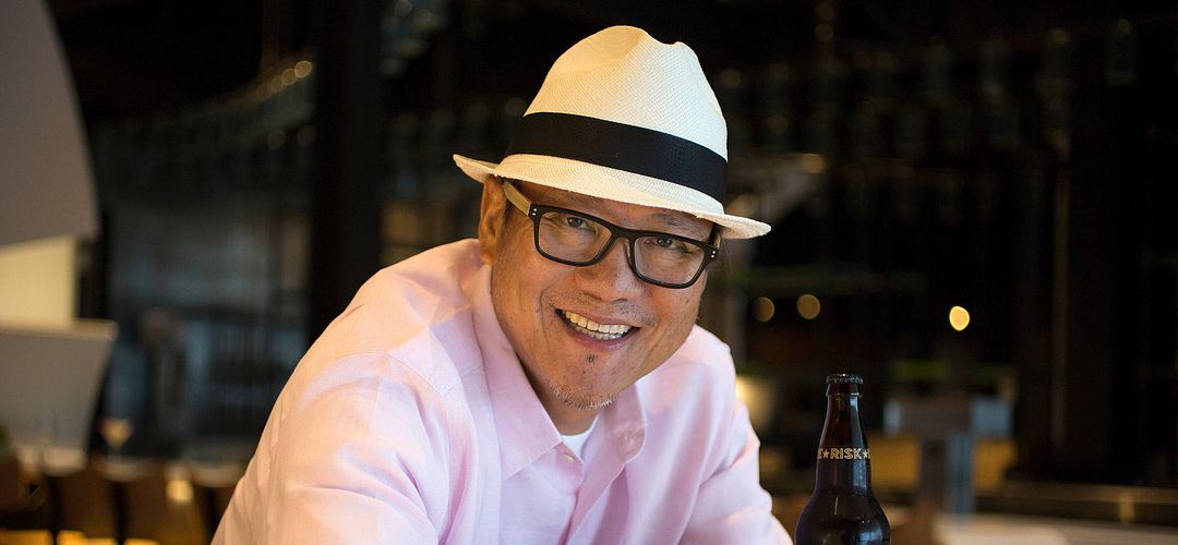 A portrait of the smiling Iron Chef Masaharu Morimoto at Morimoto Asia