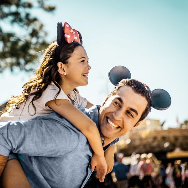 Father giving daughter a piggy back ride at the Walt Disney World Resort