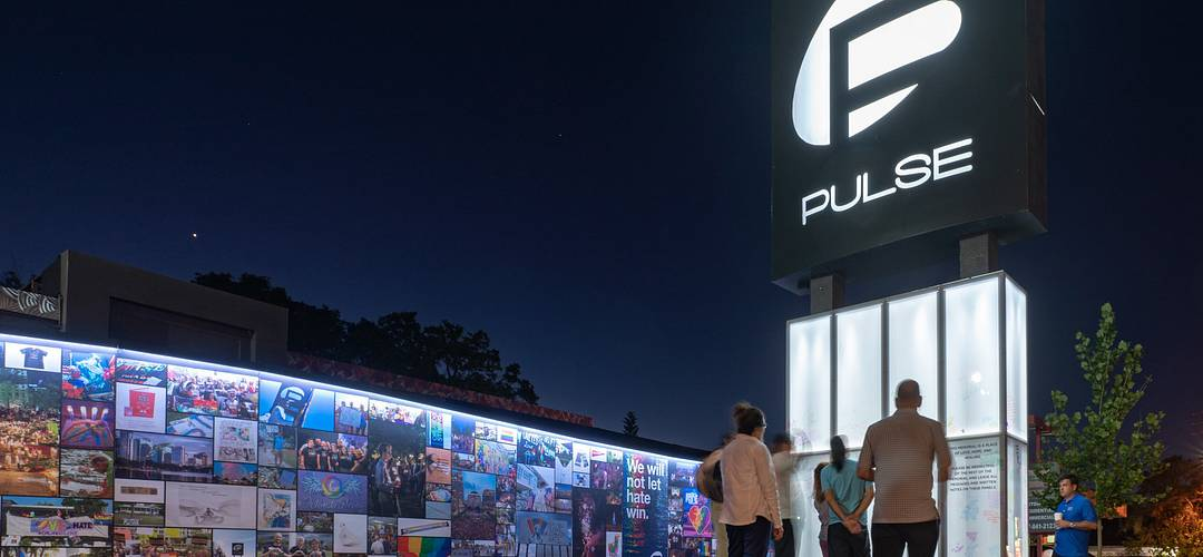 Nighttime view and row of photos at the Pulse Nightclub Memorial