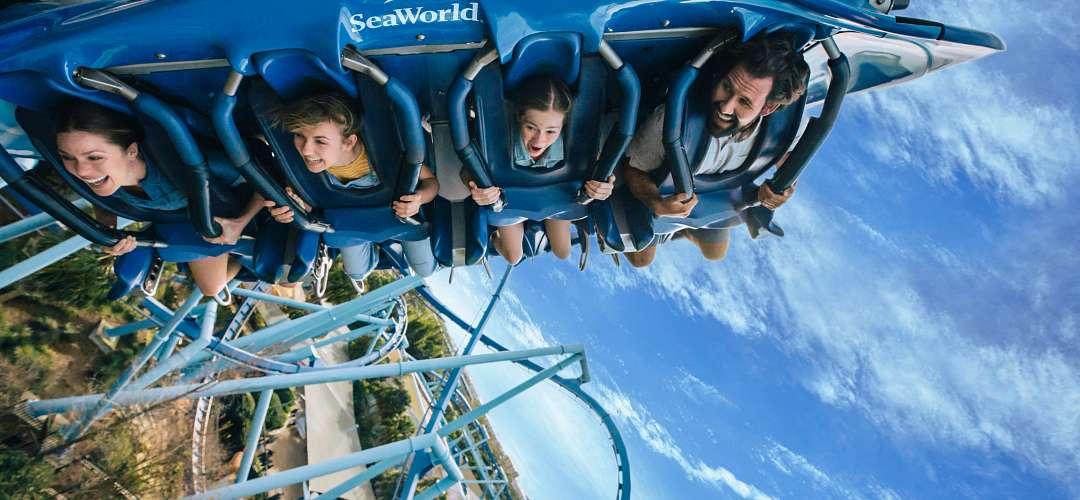A family screaming while riding SeaWorld's Manta Coaster