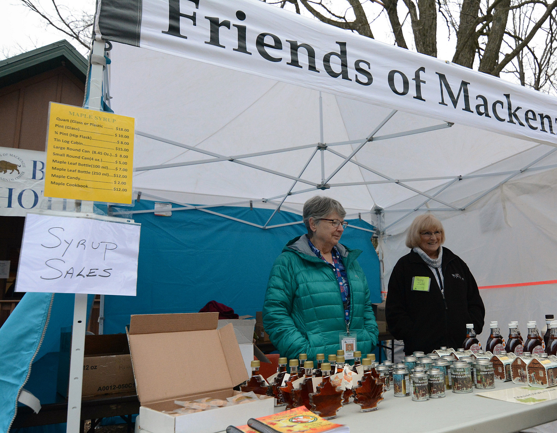 Friends of MacKenzie Center selling syrup at Maple Syrup Festival