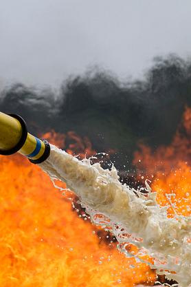 Fire-fighting foam being sprayed on a fire
