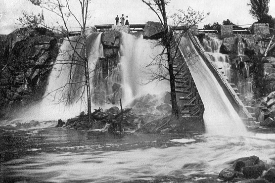 Historic black and white photo of the Prairie River flowing over a dam