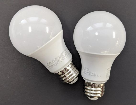 two compact fluorescent light bulbs