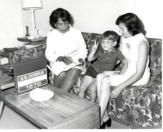 census worker taking information from a mother and son in 1970
