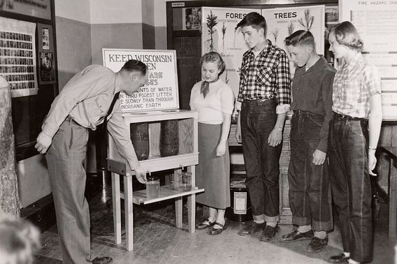 teenagers at school in 1952 with Conservation Department forester H.J. Hovind