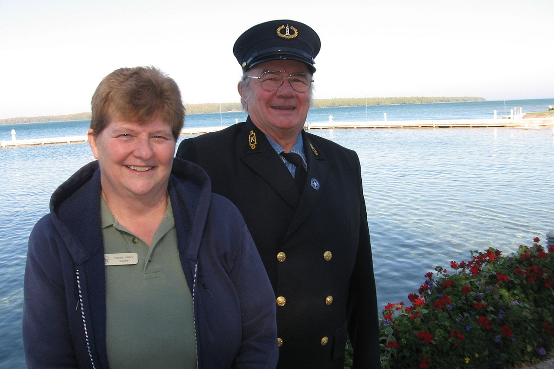 Woman and man, who is in uniform, standing with Lake Michigan in background
