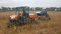 machinery working in field
