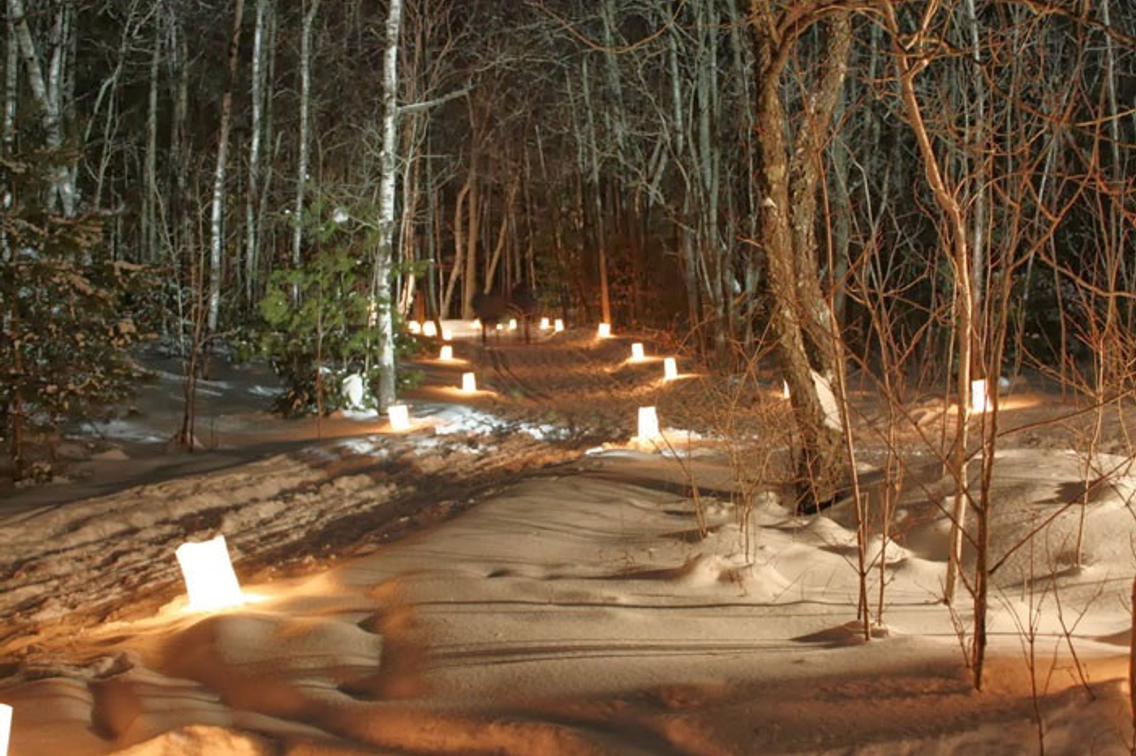 Candles in snow along trail at state park