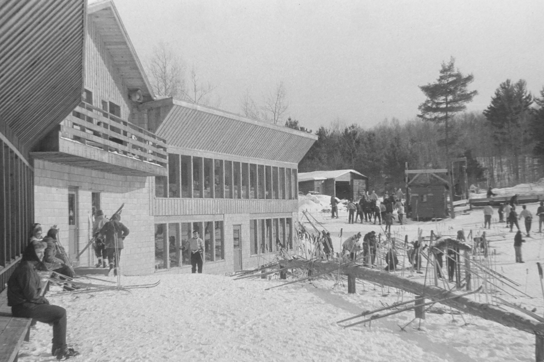 Historic photo of cross-country skiers gathered around Telemark Lodge in Cable, Wisconsin
