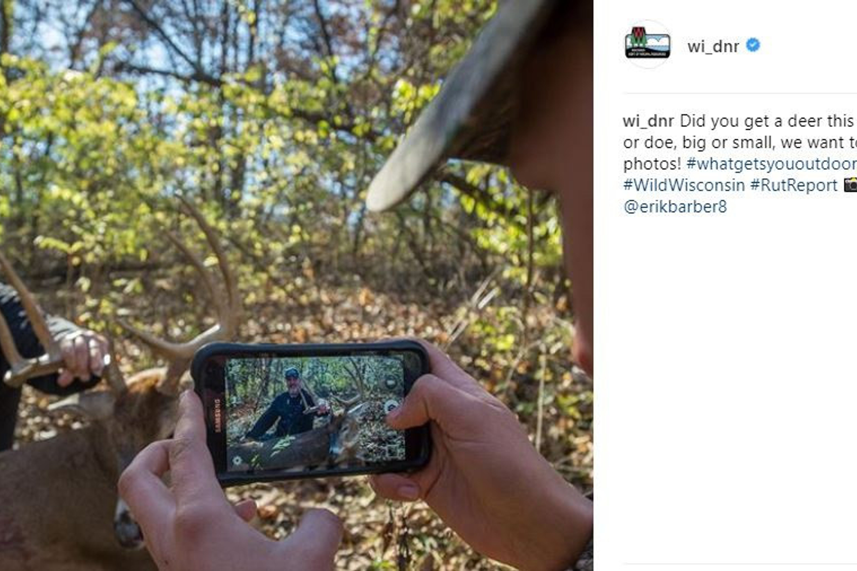 Photo of a smartphone user taking a picture of a hunter