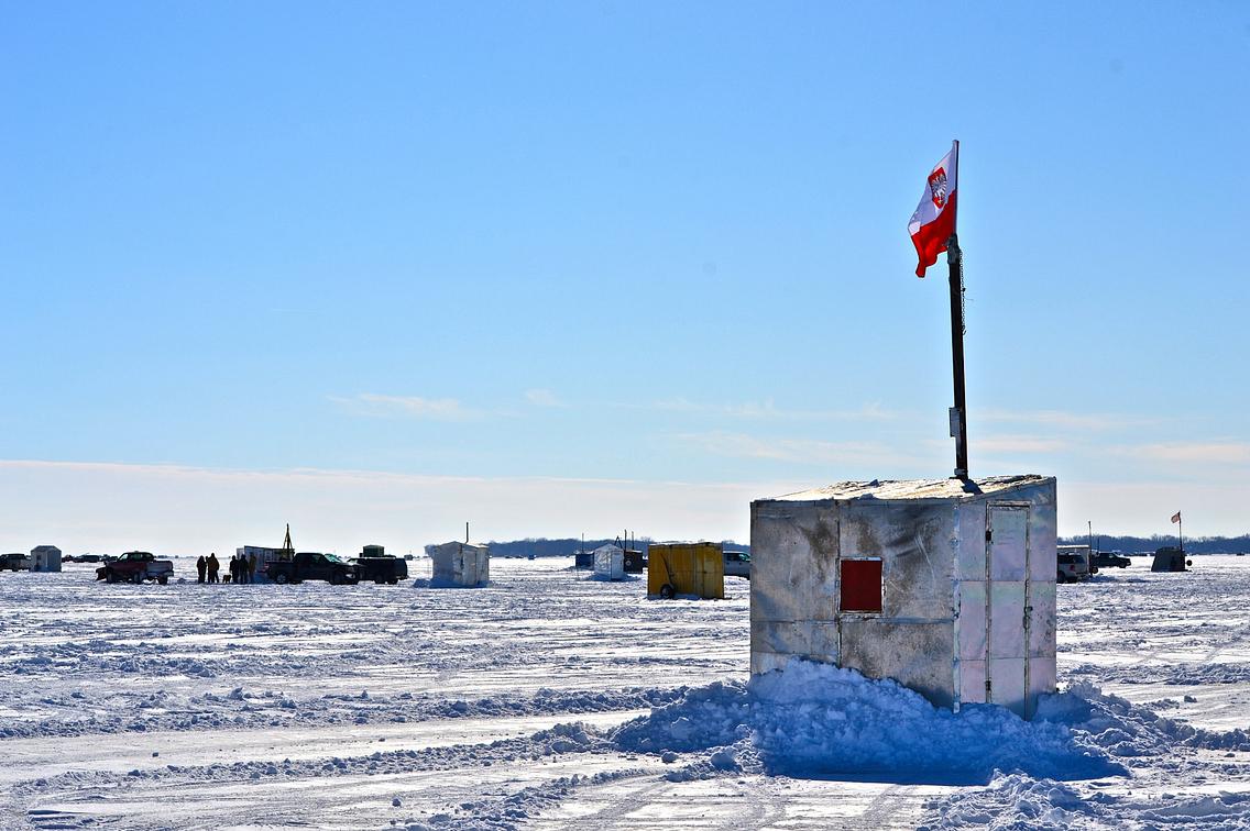 Ice fishing shanties on frozen lake